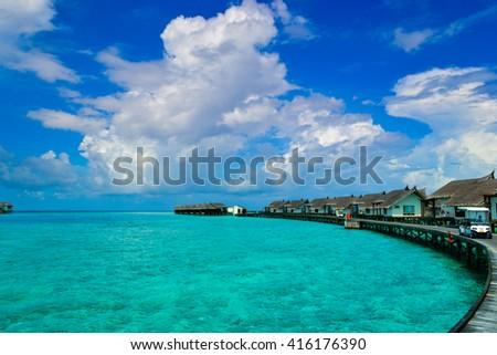 ocean villas maldives in lagoon - stock photo