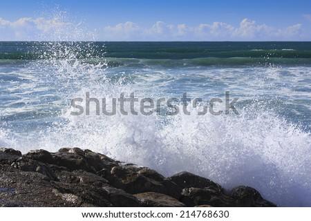Ocean wave hit the rock  - stock photo