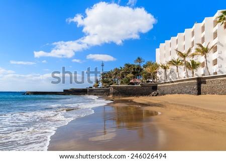 Ocean wave of sandy tropical beach in Puerto del Carmen, Lanzarote, Canary Islands, Spain - stock photo