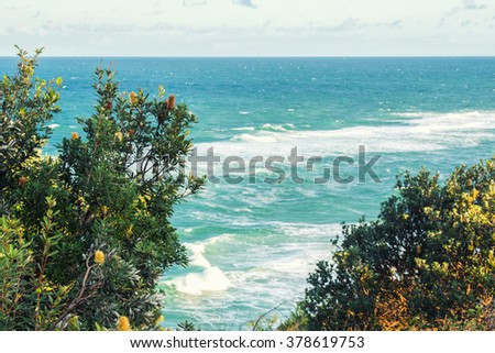 Ocean waves and beach at Point Lookout on North Stradbroke Island during the afternoon.