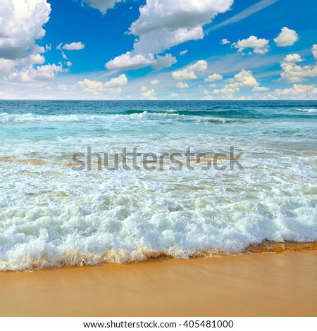 Ocean waves and blue sky - stock photo