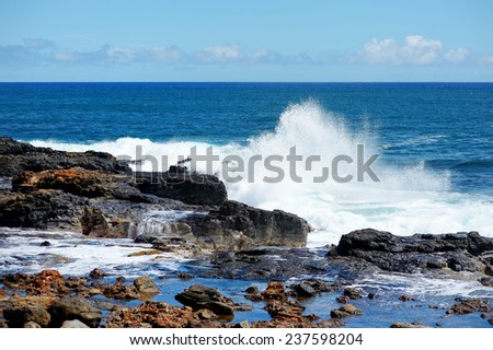 Ocean waves crashing on rocks, Kauai, Hawaii - stock photo