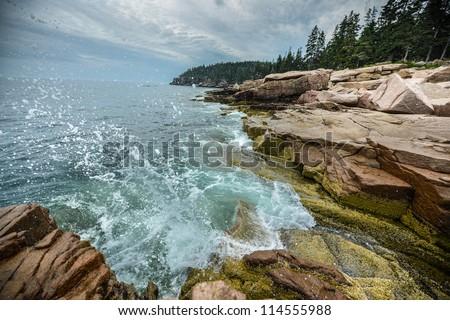 Ocean Waves crashing on the rocky shore of Acadia National Park - stock photo