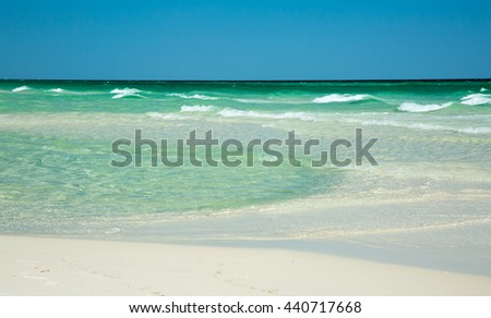 Ocean waves/Texture/The water off the coast of Florida can be very clear and have an emerald color.  - stock photo