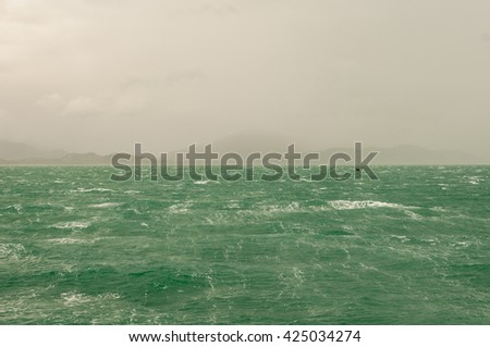 Ocean waves wind, rain during the monsoon season.  - stock photo