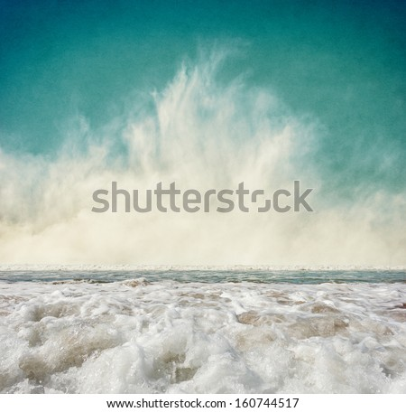 Ocean waves with fog rising at the horizon.  Image displays a pleasing grain texture at 100 percent.