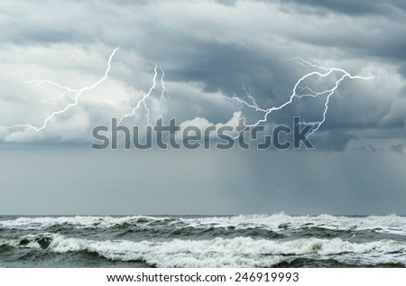 ocean with big waves and lightning
