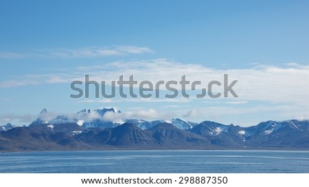 Ocean with the mountain ranges in the background in Hornsund, Svalbard