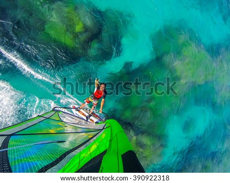 Ocean world of windsurfing over coral reef - stock photo
