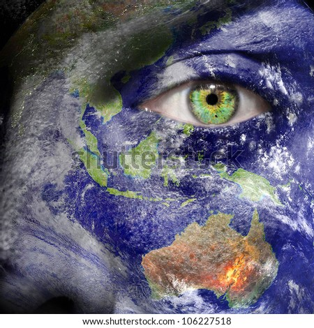 Oceania painted on face to draw attention for a green and to create awareness for climate change - Elements of this image furnished by NASA - stock photo