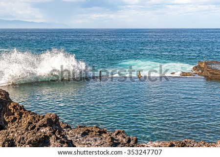 Oceanic wave hit the barrier of natural pool at the Tenerife island