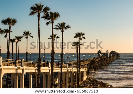 OCEANSIDE, CALIFORNIA - MARCH 23, 2017:  The Oceanside fishing pier, first built in 1888 and with its last reconstruction in 1987, it is now the longest wooden over-water pier on the West Coast.