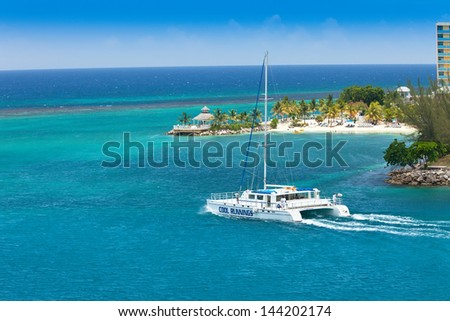 OCHO RIOS, JULY 14:  A large catamaran heading out to the Caribbean Sea on July 14, 2011. Cool Runnings Catamarans offers daily cruises to the famous Dunn's River Falls in Ocho Rios, Jamaica. - stock photo