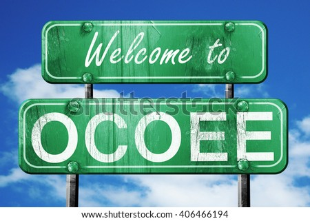 ocoee vintage green road sign with blue sky background
