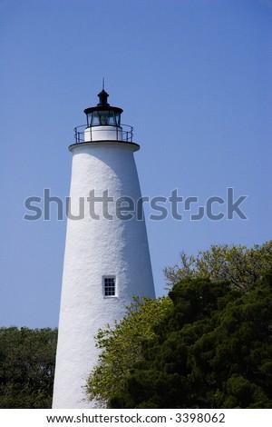Ocracoke Lighthouse   Built in 1823, the Ocracoke Lighthouse is the oldest active lighthouse in North Carolina. Located in a fishing village on Ocracoke Island. - stock photo