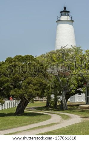 Ocracoke Lighthouse in North Carolina. Located on Ocracoke Island. - stock photo