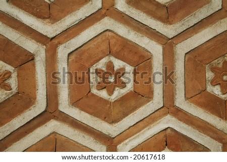 Octagonal Orange Brickwork with Flower Pattern - stock photo