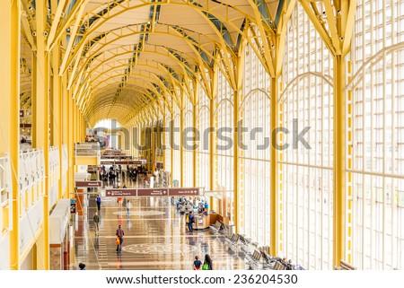 October 2, 2014: DCA, Reagan National Airport, Washington, DC - passengers waiting in the corridor for a flight - stock photo