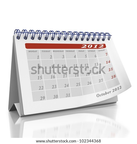 October desktop Organizer on a white background with a page curl on the top page - stock photo