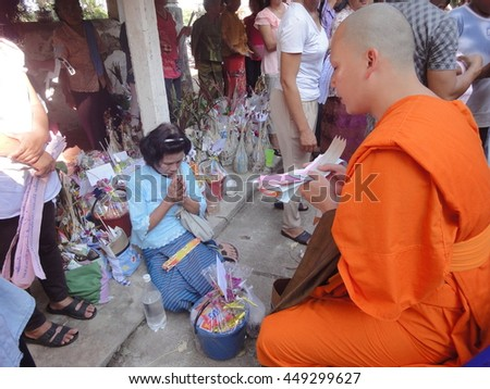 October 30, 2013 : Getting a Blessing from Buddhist Monks in tan kuai salak, a tradition of offering things to monks. called by northeastern people at mae tip luang Temple, Ngao, Lampang, Thailand