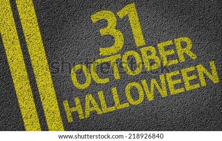 October 31 Halloween written on the road - stock photo