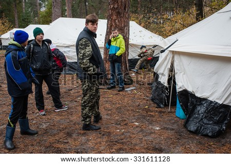 October 24, 2015. Kiev region, Ukraine. Red Cross volunteers with scouts testing the tent city, which will be used in case of influx of Syrian refugees.