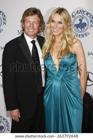 October 25, 2008. Nigel Lythgoe and Alana Stewart at the 30th Anniversary Carousel Of Hope Ball held at the Beverly Hilton Hotel, Beverly Hills. - stock photo