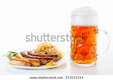 Octoberfest menu, beer mug with foam, a plate of sausages and sauerkraut. Oktoberfest meal. - stock photo