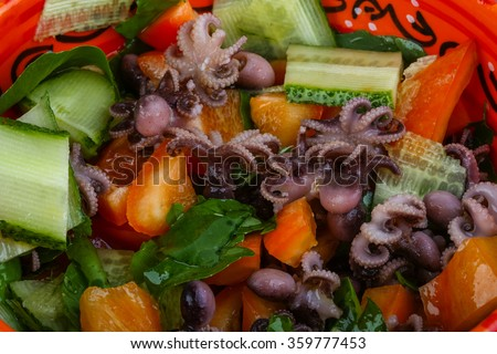 Octopus salad with cucmber, pepper and basil leaves