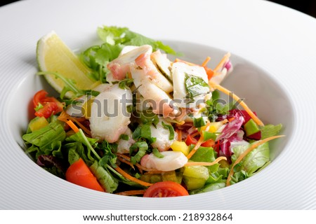 octopus salad with lemon slice lettuce and potatoes  - stock photo