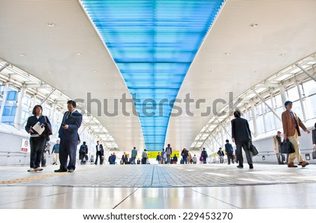 ODAIBA, TOKYO - OCTOBRE 11, 2014: Passageway of Odaiba railway station of Japan Railway & subway lines. Odaiba is a large artificial island in Tokyo. - stock photo