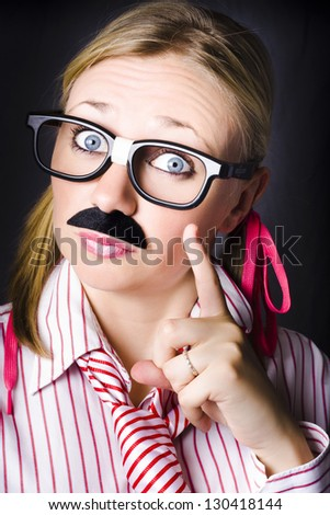 Odd female business scientist wearing moustache gesturing knowledge to the solution when answering a complex business equation