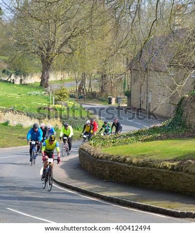 ODELL, BEDFORDSHIRE, ENGLAND - APRIL 03, 2016: Cycle road racers on a country road at Odell Bedfordshire  - stock photo