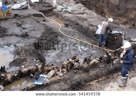Odense, Denmark - October 3, 2016: Street being dug up with historical findings being tagged by archaeologists on site in Odense, Denmark, Scandinavia