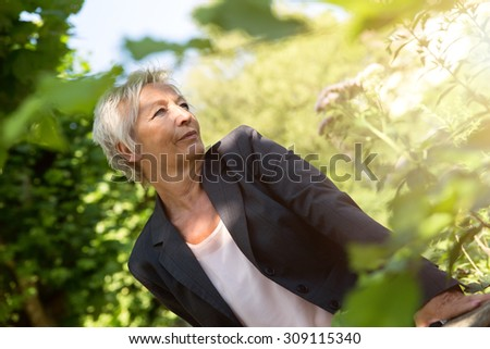 oder business woman enjoy the sunshine in the nature - stock photo
