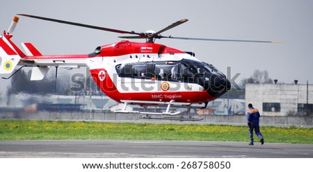 Odessa, Ukraine -29 April 2010: A helicopter of the Ministry of Emergency takes off from the airport in the disaster zone with doctors to save the Ministry of Emergency Situations of flood victims - stock photo