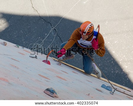 Odessa, Ukraine - 02 April 2016: athletes train for climbing and ice climbing on the steep wall of the training stand