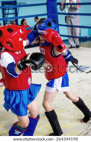 Odessa, Ukraine, April 26, 2015: Cup of Ukraine. Thai boxing among children. Kids boxing, kickboxing children. Children fight with these adult emotions. Popularization of sports and healthy lifestyle - stock photo