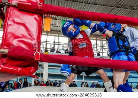 Odessa, Ukraine, April 26, 2015: Cup Ukraine on Thai boxing among children. Kids boxing, kickboxing children. Children fight with these adult emotions. Popularization of sports and healthy lifestyle