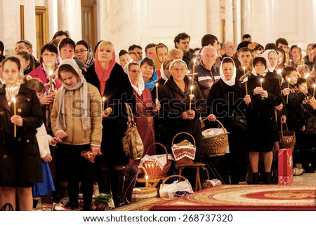 Odessa, Ukraine - April 11, 2015: Easter, parishioners of the Orthodox Church. Holy Fire from Jerusalem at the feast of the Resurrection of Christ. Orthodox Christian Easter