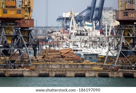 ODESSA, UKRAINE - April 8: large cranes for loading goods on large marine cargo ships at the container terminal in the port of Odessa sea port on a foggy day , April 8, 2014 Odessa, Ukraine