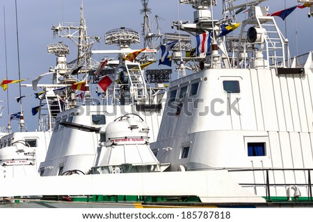 ODESSA, UKRAINE - APRIL 6: Maritime Boundary  Navy, naval ships and sailors in the harbor  Odessa. Military equipment of ships , guns and torpedo installation , marine flags , Ukraine, April 6, 2014 .