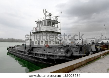ODESSA, UKRAINE - April 15: Old river trading port Ust -Danube . Human outdated repair river vessels , barges at the shipyard docks. Ancient Technology , April 15, 2014 Odessa, Ukraine