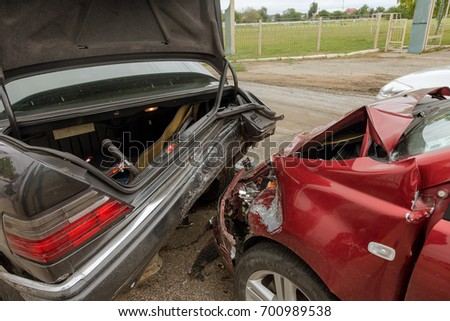 ODESSA, UKRAINE - August 22, 2017: Accident in car accident on street, damaged cars after collision in city. Cars drove into each other on city street. large car accident, caught up in train