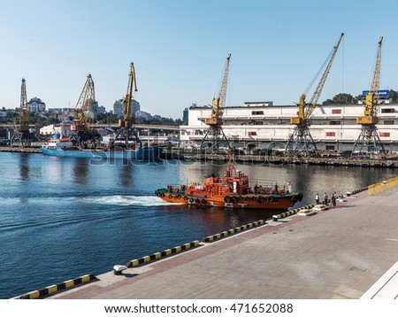 Odessa, Ukraine - August 15, 2016: Container cranes in cargo port terminal, cargo cranes without job in an empty harbor port. A crisis. Odessa, Ukraine, August 15, 2016