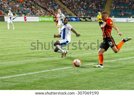 ODESSA, UKRAINE - August 14, 2015: FC Shakhtar Donetsk and FC Dnipro Dnipropetrovsk in the match for the Cup of Ukraine are fighting for the ball. Detail of the game.