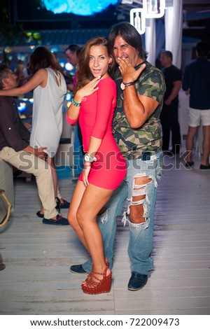 Odessa, Ukraine August 8, 2014:Ibiza club. People smiling and posing on cam during concert in night club party. Man and woman have fun at club. Boy and girl at night club party