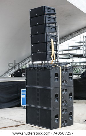 ODESSA,UKRAINE-21 AUGUST,2017:Professional concert audio system.Big black concert speakers connected in one sound system outdoor.Music festival speaker box.Industrial audio equipment
