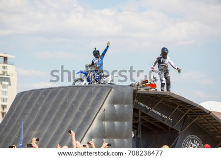 Odessa, Ukraine August 25, 2017: Professional rider at the FMX (Freestyle Motocross) make an acrobatic jump at the motorshow. Open air festival of extrim sport.