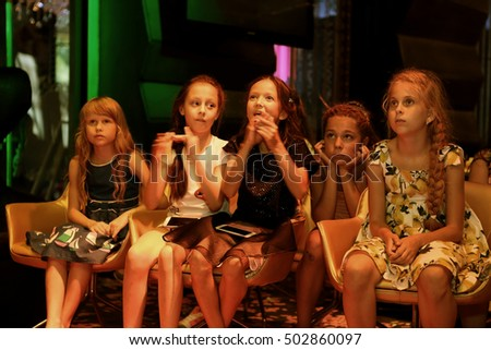 ODESSA, UKRAINE - 30 August 2016: The audience at the concert. Spectators watch the children emotional performance of children shows. Baby spectators at Children's Festival